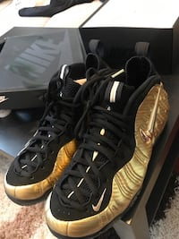 Pair of black-and-gold nike foamposite shoes Abbotsford, V3G