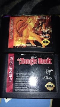 two Sega Genesis game cartridges