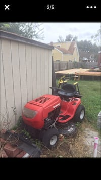 Red and black Yard Machines ride on lawn mower screenshot