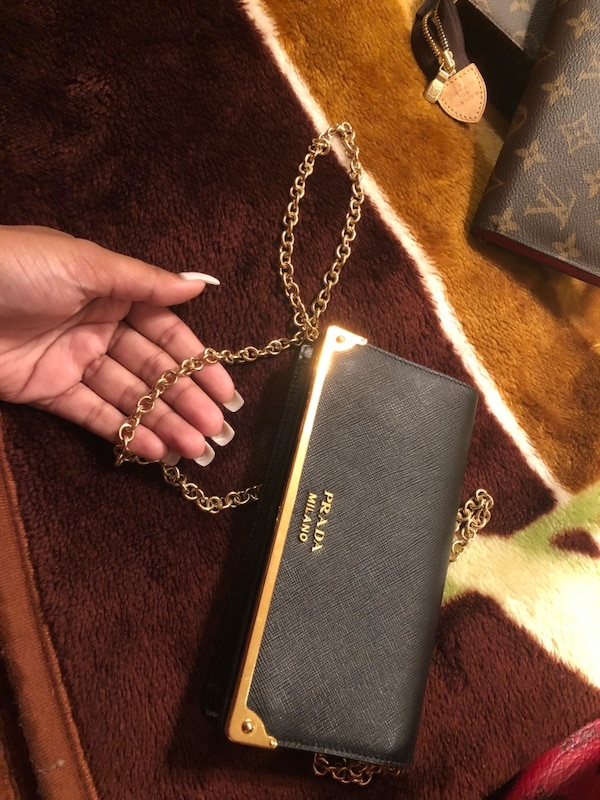 bd0ee4aa91d5c5 1/2. 1/2. Sold. Tap to see more pictures. Swipe to see more info. Prada  Clutch Purse w. Gold Chain. HomeFashion and Accessories Floral Park