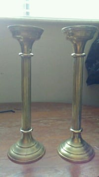 two silver candle holders