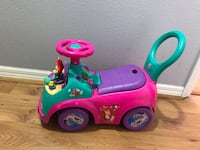 toddler's pink and green ride on toy Seffner, 33584