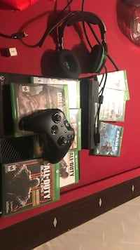 black Xbox One console with controller and game cases Wesley Chapel, 33544