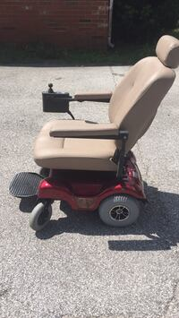 red and black mobility scooter Bushnell, 33513