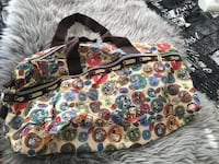 black, white, and yellow floral print bag Calgary, T2H
