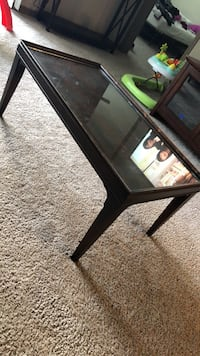rectangular brown wooden framed glass top coffee table Altamonte Springs, 32714
