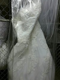 white spaghetti strap wedding gown