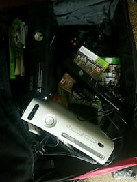2 Xbox 360s with virtual cam games in big suitcase