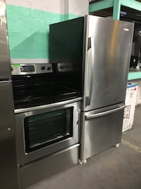 Whirlpool stainless steel electric stove and fridge package deal  Baltimore, 21223