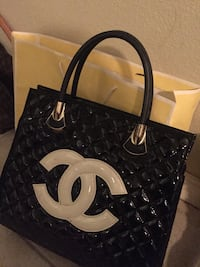 black and white quilted Chanel leather tote bag