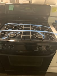 Ge gas stove working perfectly with 4 month warranty  Baltimore, 21223