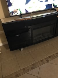 Black tv stand with fireplace and bluetooth 72 inches long, 31 inches tall