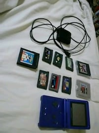 black Nintendo DS with game cartridges La Salle, 61301