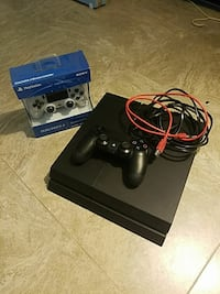 black Sony PS4 500gb console with 2 controllers