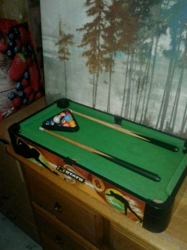 green and brown billiard table.24inches down 12 ac