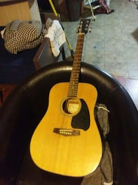 dreadnought brown and black acoustic guitar
