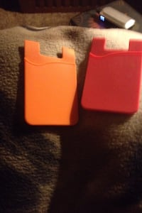 two orange-and-red plastic case Cabot, 72023