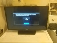 black flat screen TV with remote Greenville, 16125