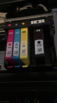 four assorted colors of HP ink cartridges 2251 mi