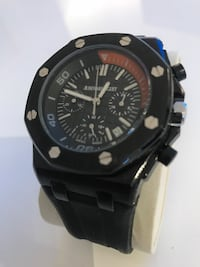 round black chronograph watch with black strap Toronto, M2K 0E9
