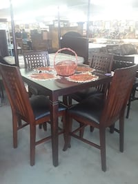 square brown wooden dining table set