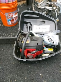 black and red Troy-Bilt chainsaw 33 km