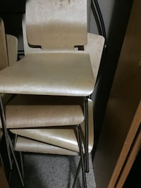 Eight brown wooden armless chairs will sell individually