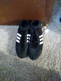 pair of black Adidas low-top sneakers