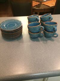 8 piece teacups and saucer stoneware dishes . Never used from pier one.  Pretty blue/turquoise with gold highlights  North Little Rock, 72118