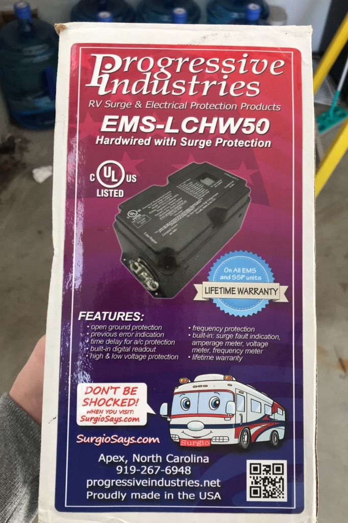 Photo 50A 5th wheel hard wired surge protector. Still in box. Never used!!