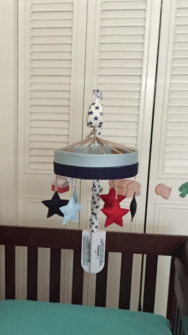 Gray, black, and red crib mobile