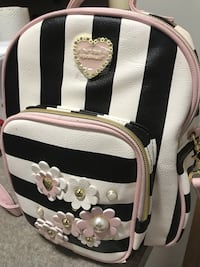 White and black leather Backpack Toronto, M5G 2B4
