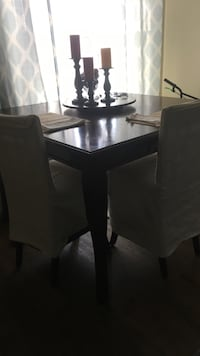 Square brown wooden table with chairs dining set
