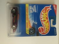 black and red Hot Wheels car with pack