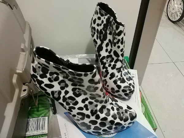 pair of white-black-and-gray leopard skin print leather heeled booties 442ca278-399a-444f-a592-2fb10961fe08