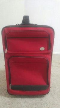 black and red softside luggage 541 km