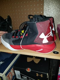 pair of gray-black-and-red Under Armour Charged high-top basketball shoes