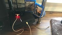 Black sony ps4 console with controller and game cases Kingston, K7K 5Z4