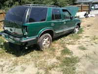 green crew cab pickup truck with camper shell Spokane, 99212