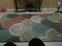 blue, pink, green, and red multi-colored area rug