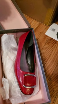 pair of red leather pointed toe heels in box Baltimore, 21217