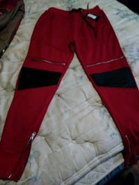 red and black Nike track pants Darby, 19023
