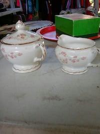 two white-and-pink floral ceramic sauce bowls