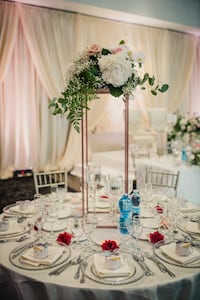 Tall and short wedding centerpieces / rose gold