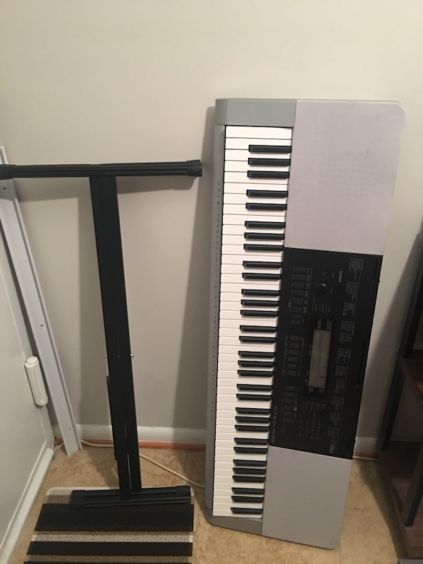 76-key Casio keyboard and stand