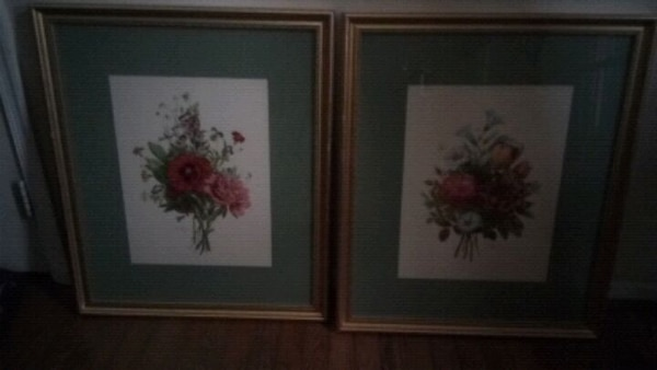 Beautiful flowers picture on golden frame.