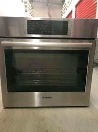 stainless steel and black microwave oven Sainte-Thérèse