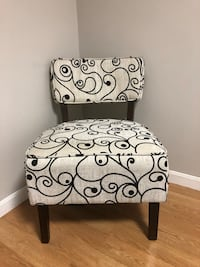 White and black floral padded sofa chair