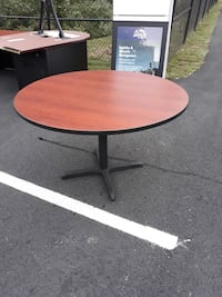 Round brown wooden pedestal table Manassas