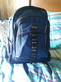 blue and black canvas backpack